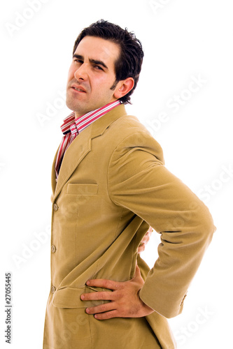 A young business man with a backache. Isolated on white