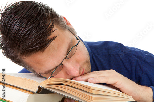 nerdy geek fall asleep on books over white background