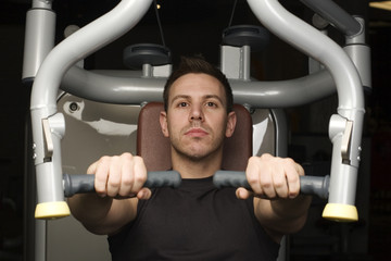 Young man working out on excerise machine