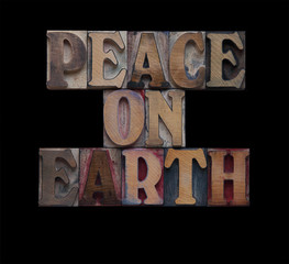 the words peace on earth isolated on black