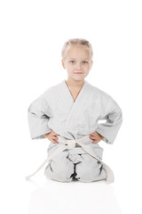 girl - karateka in kimono on a white background