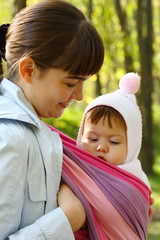 Walk with the child in a baby sling.