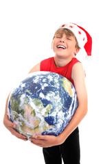 Christmas boy hugging planet earth