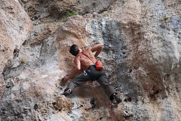 Rock climber on the cliff