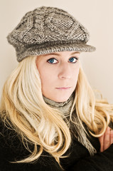 Blond wearing knitted hat