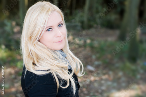 Blond woman in park