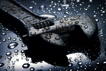 Adjustable spanner , water drops background , wrench