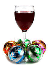 glass of red wine and decoration for ñhristmas