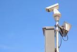 Surveillance Security Camera or CCTV on blue sky poster