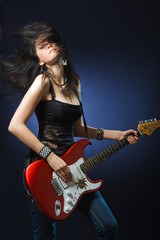 Beautiful dancing girl with a guitar