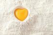 Leinwanddruck Bild - love to bake it!  egg  yolk on flour, full frame