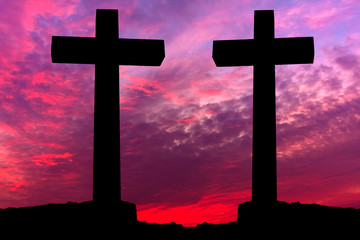 Crosses silhouette over a dramatic sky at sunset