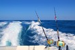 Leinwanddruck Bild - Trolling fishing boat rod and golden saltwater reels