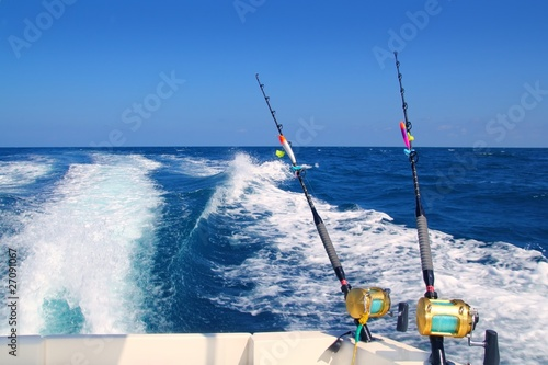 Leinwanddruck Bild Trolling fishing boat rod and golden saltwater reels