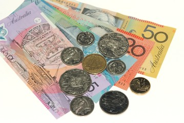Australian banknotes and coins on plain white background