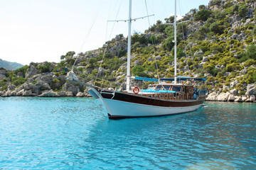 Mountains and sea view and small yacht. Turkey.