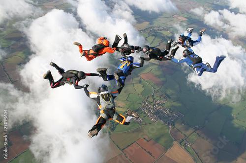 Leinwandbild Motiv Eight skydivers in freefall
