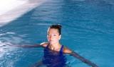 blue pool woman beautiful swimming in water