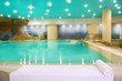 spa indoor turquoise water white towel