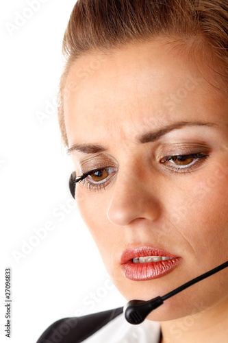 worried modern business woman with headset  isolated on white.