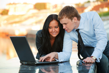 Young couple with laptop.