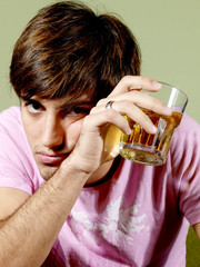 Young Man Drinking Beer. Model Released