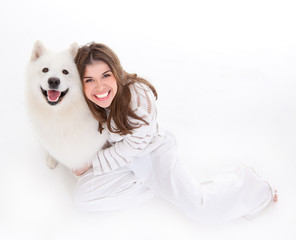 woman with white dog, smiling, looking up