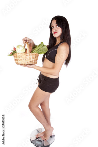 Woman fitness scales vegetables