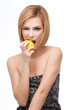young woman biting on a whole lemon