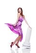 Beautiful female wearing lilac dress, flirting, on white