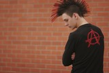 Man With Mohawk And Anarchy Symbol On Clothing