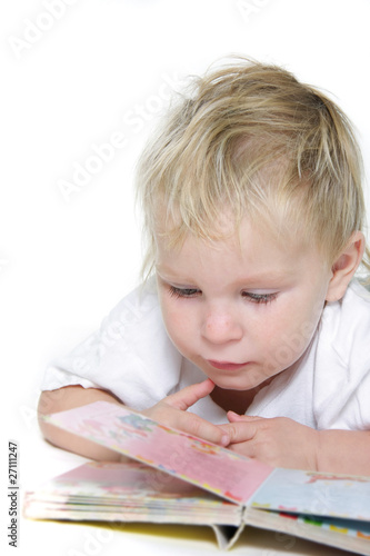 cute child reading book over white