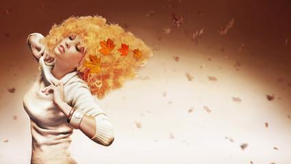 Orange haired beauty on studio background