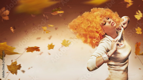 Young beauty on autumn studio background