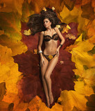 Cute woman laying on the leaves