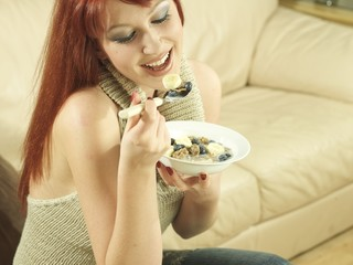 Young Woman Eating Cereal. Model Released