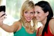 Teenage Girlfriends Taking Photographs. Model Released