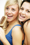 Teenage Girls Singing Into Hairbrush. Model Released