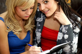 Teenage Girlfriends Writing Diary. Model Released