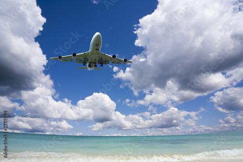 Beautiful sea and sky with airplane .