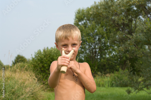 Boy with a slingshot.