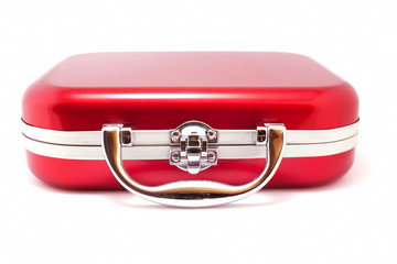 Red suitcase isolated over white
