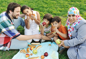 Muslim family, mother and father with children together