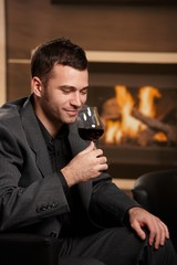 Man tasting wine at home