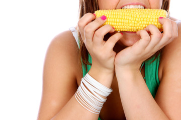 Young Woman Eating Corn on The Cob. Model Released