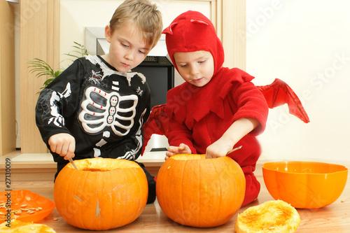 boys carving pumpkins