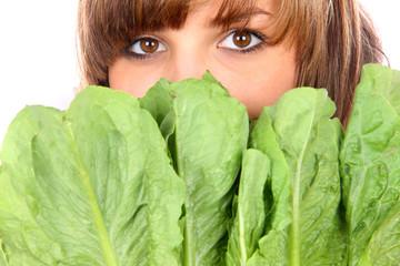 Teenage Girl Hiding Behind Cos Lettuce Leaves. Model Released