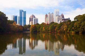 Midtown Atlanta reflected in lake.