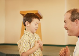 Boy Talking To Man In Church