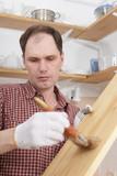 Varnishing wood shelves poster